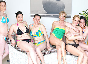 Lovely mature women relaxing in a sauna