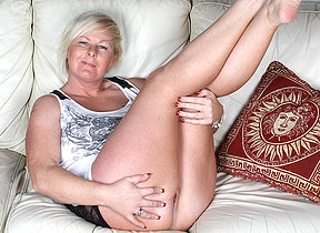 Horny blonde housewife bringing off on the couch