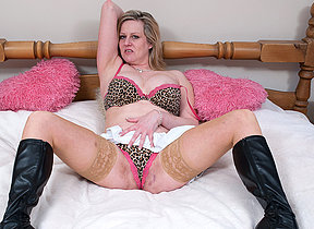 Blonde mature old bag getting very wet on her bed