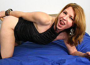This horny MILF loves to get wet on her bed