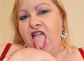 Big mama playing with her huge knockers and pussy