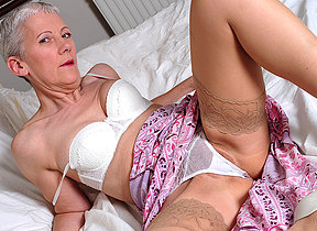 Naughty mature old bag getting wild on bed