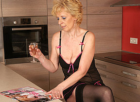 This blonde mature floozy loves to masturbate in her kitchen
