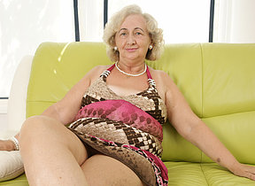 mature grandma playing close to a purple dildo