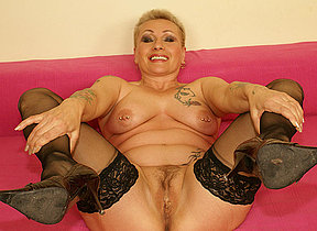 This horny mature slut really loves her toy