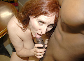 Horny red mature battleaxe acquiring fucked by a hard black cock