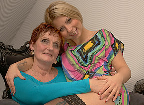 Two naughty old with the addition of young lesbians do it on the couch