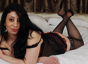 Hot British MILF getting naked with an increment of naughty