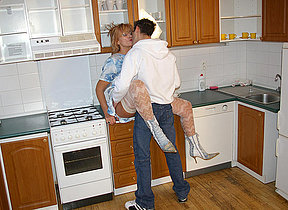 Horny housewife fucking in their way kitchen