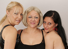 Three old and young lesbians make out on the settee
