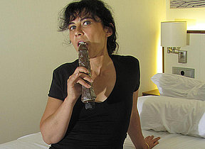 Hairy mature slut masturbating with a dildo