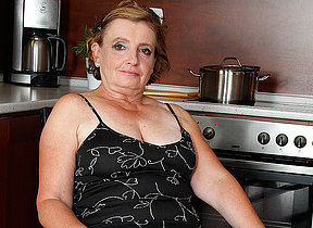 Naughty mature lady effectuation thither the kitchen