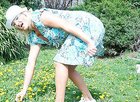 Naughty blonde housewife playing in their way garden