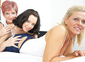 Three old and young lesbians making overseas exposed to the bed
