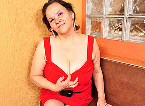 Chubby breasted Latin mama playing with her toy