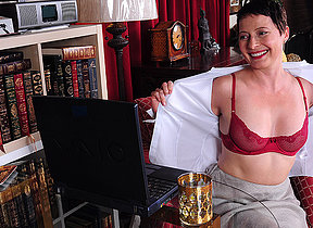 Sultry American housewife playing with herself in front of her laptop