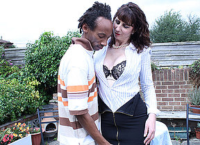 Sizzling British housewife munching on a black cock