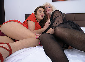 Two horny old and young lesbians get it on