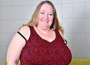 Big breasted mature BBW carryingon with her pussy