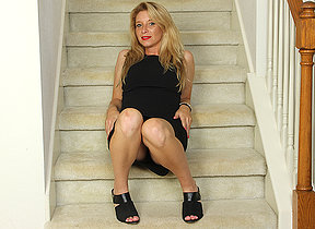 Naughty American MILF playing with her pussy on a difficulty stairs