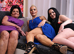 Three old and young lesbians make out on the couch