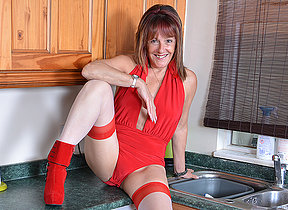 British housewife playing in her kitchen