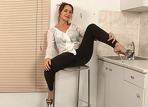Hairy housewife getting wet in her kitchen