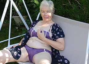 Naughty granny carryingon in the garden in her pussy