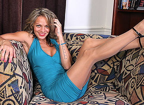 Naughty American MILF playing with herself on the couch