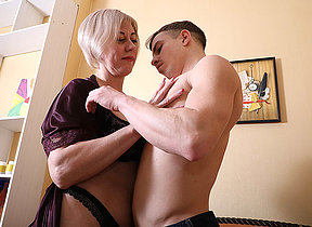 Horny mature lady having fun with her toy crony