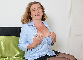 Busty British housewife effectuation with her tits and pussy