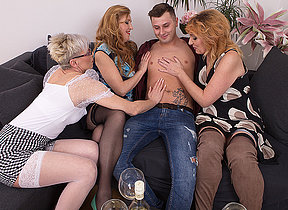Four horny mature ladies share their toyboys cock