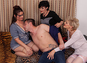 Three sexy mature ladies share the young cleaners big cock
