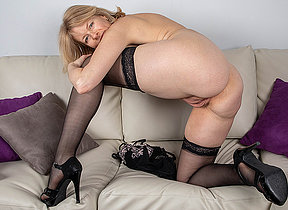 Crestfallen Milf strips off all her clothes and plays with her shaved pussy
