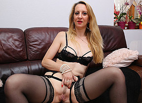 Sexy French Milf masturbating on the couch