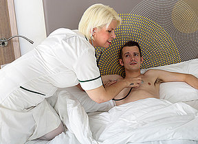 Horny mature nurse gives her young male patient a very special hallucinogenic